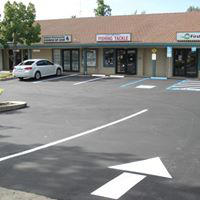 Parking lot in front of stores.